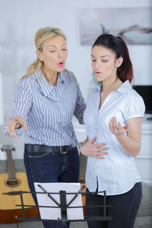 Women in singing lesson Stockfoto