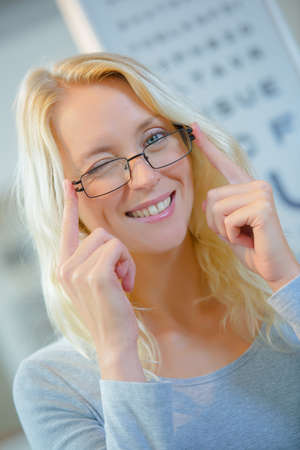 Portrait of woman wearing glasses and winking Stock Photo