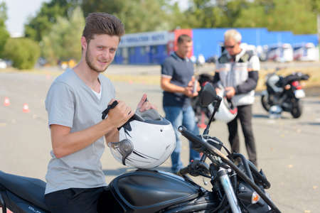 bollards: Young man on motorcycle preparing to do a training course Stock Photo