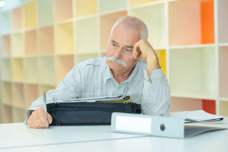 elderly man with thoughful face indoors