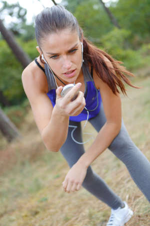 poised: Poised lady with stopwatch Stock Photo