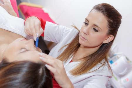 makeover: beautician giving facial makeover Stock Photo