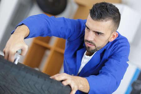 fixing the tire Stock Photo