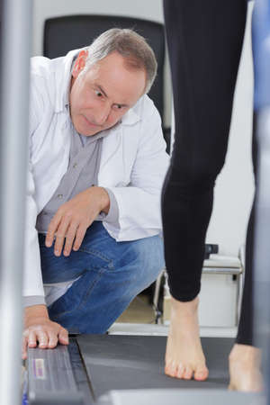 physical therapist or podologist Stock Photo