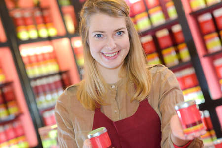 smily young woman choosing selling tea
