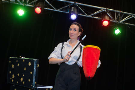 magus: woman magician at stage