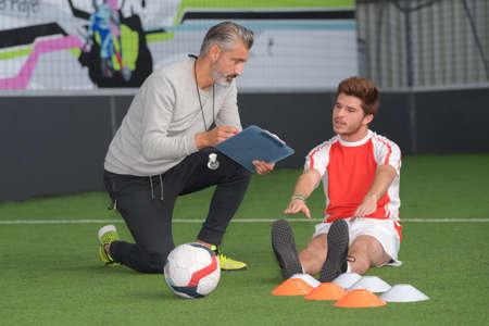 Voetbal coach en voetballer portret