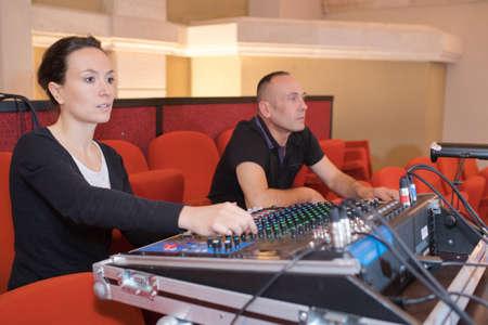 keyboard: engineer working at mixing desk in recording studio Stock Photo