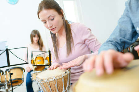 Music rehearsal, woman playing bongos
