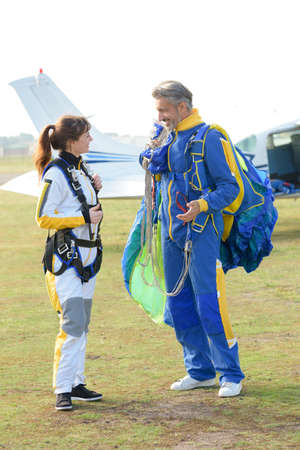 sky diving tandem getting ready to jump from the plane Stock Photo