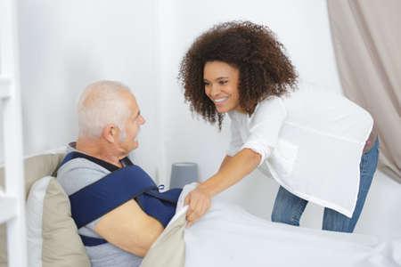 morals: woman taking care of elderly man in nursing home