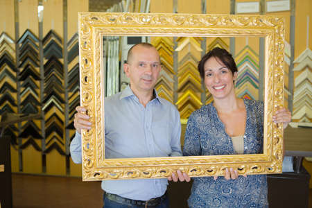 couple buying frame for their house
