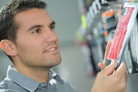 happy hansome man buying in a shopping mall Stock Photo