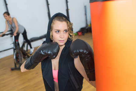 beautiful woman ready to fight at gym Banco de Imagens