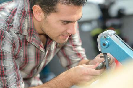 worker finishing a metal objet Stock Photo