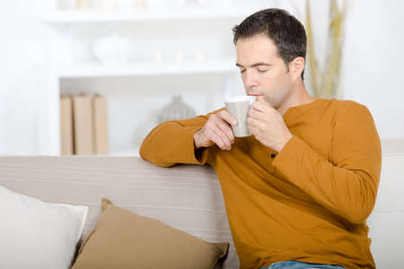 guy sniffing aroma of coffee Stock Photo