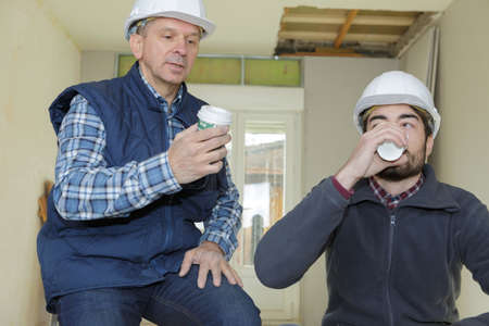 builders having a coffee break Stock Photo