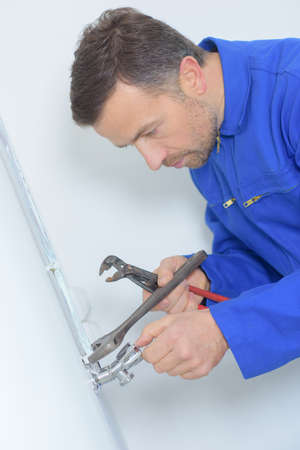 man with pliers Stock Photo