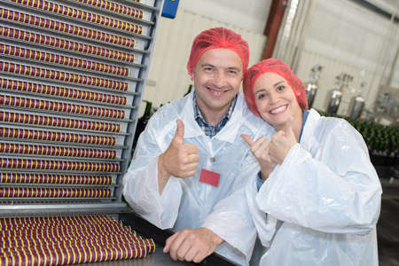 happy scientists in the factory Stock Photo