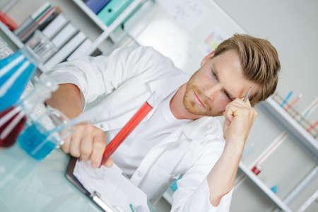analyses: scientist holding laboratory test tube