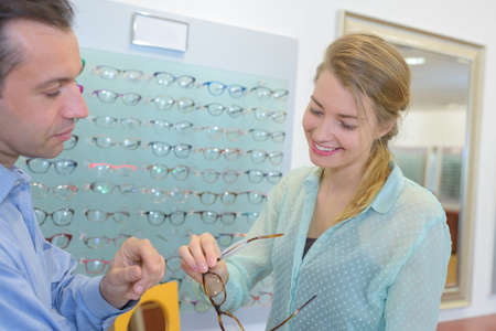 beuatiful woman is buying glasses