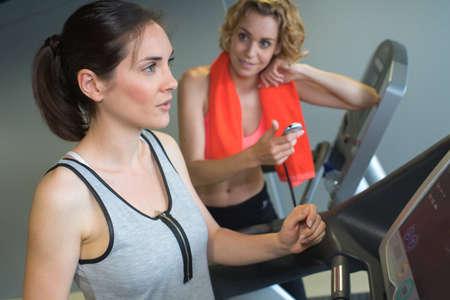 stair climber: girl exercising at the gym on stepper machine