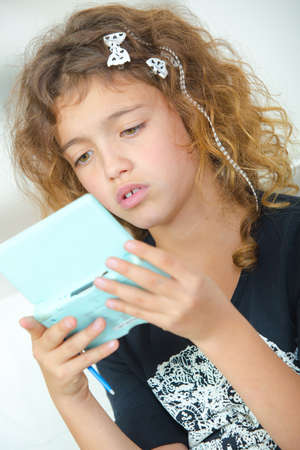 moderation: a child playing with gadgets