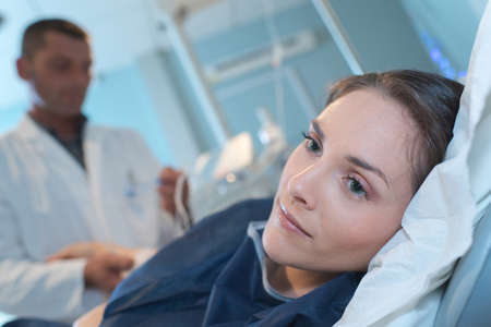 young woman worried on hospital bed Stock Photo