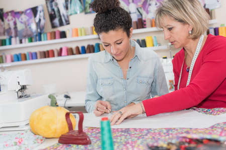 student with teacher in dressmaking class Stock Photo