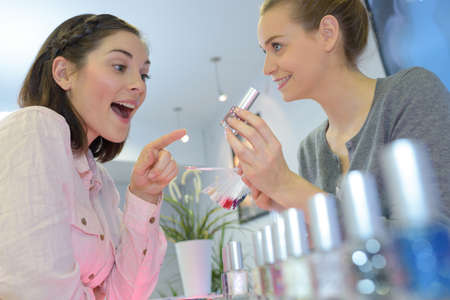 young woman chooses perfume in the shop