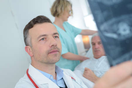 male doctor reviewing patients x ray at hospital Stock Photo
