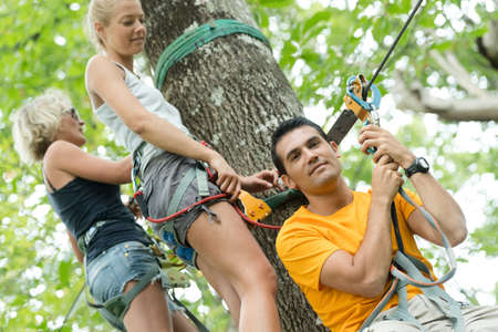 people adventure climbing high tree Stock Photo