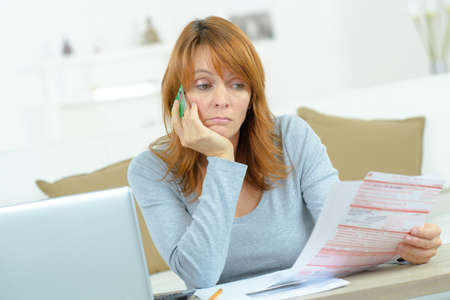 serious woman thinking about the financial issue at home