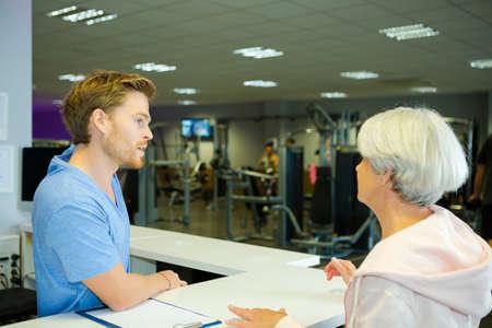 senior woman registering at health club Stock Photo