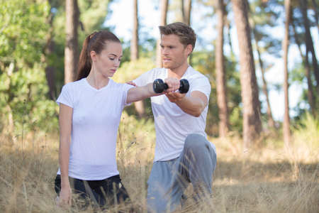 young couple lifting dumbbells