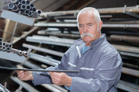designate: industrial manager in office working on metal design