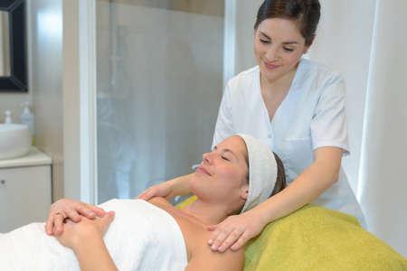beautiful young woman getting spa massage