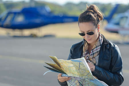 female pilot looking at the map