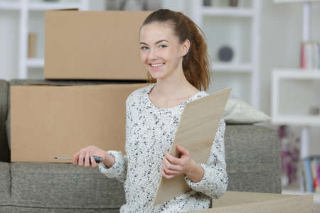 happy female moving house