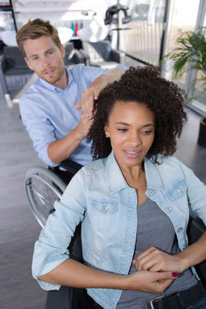 disable: disable boyfriend hairbrushing girlfriend Stock Photo