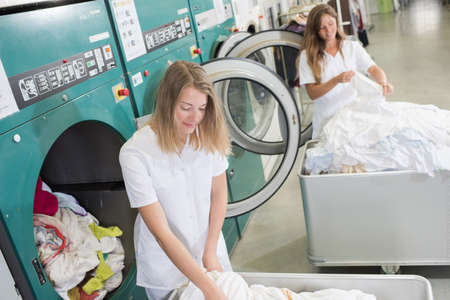 clean commercial: women working at an industrial laundry