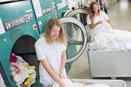 anuncio publicitario: women working at an industrial laundry
