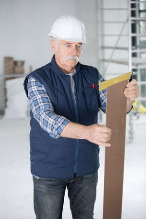 mature contractor working Stock Photo