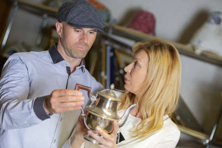 galmorous couple buying antiques at flea market Stock Photo