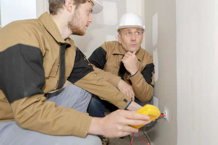 wall socket: calibrating wall sockets Stock Photo