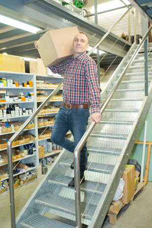 skids: man working on the stairs in the warehouse Stock Photo