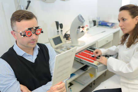 Man reading text while wearing optometrists glasses
