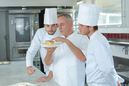 outerwear: Chef advising apprentices