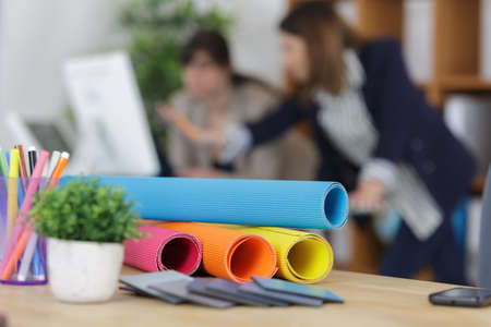 designate: architectural blueprints and blueprint rolls on the architects worktable Stock Photo