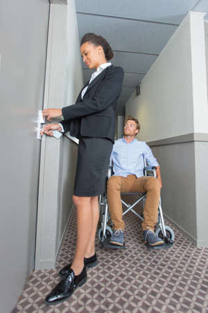 hotel staff: chambermaid helping the handicapped guest